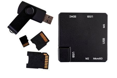 memory stick: Top view of black plastic square USB hub, memory stick and card adapters.
