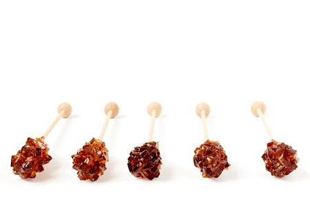 stirrer: Five brown sugar stirrers isolated on white