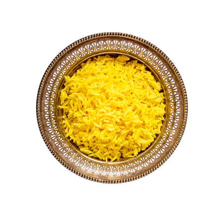 curcumin: Top view of an antique metal bowl with cooked turmeric jasmine rice isolated on white Stock Photo