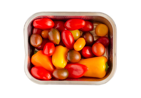 Disposable Aluminum foil grilling tray with an assortment of cherry tomatoes and small peppers ready for cooking Reklamní fotografie