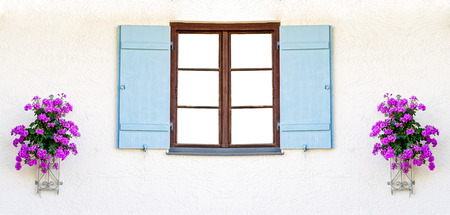 Empty wooden window frame with light blue shutters and flowers on the sides