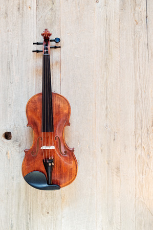 Top view of a standard violin made of wood on a weathered wood surface Reklamní fotografie
