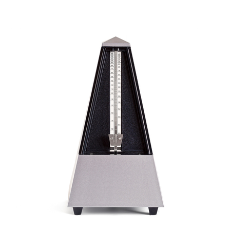 Stopped pyramid shaped metronome in plastic housing isolated on white Reklamní fotografie - 71289938