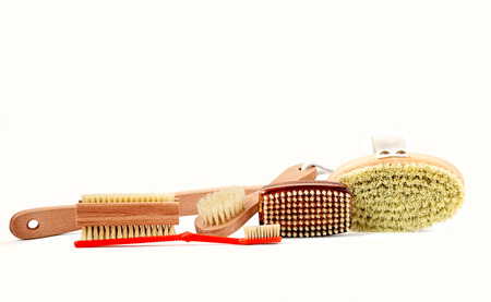 Assortment of wood and plastic brushes with natural bristles isolated on white