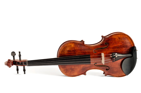 Reclined standard violin made of wood isolated on white