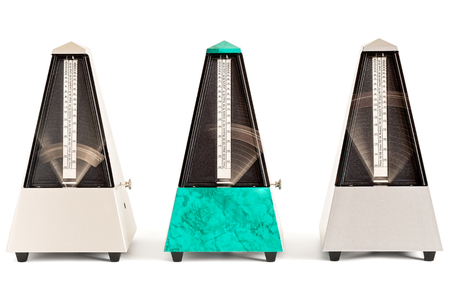 Three swinging pyramid shaped metronomes in plastic housing isolated on white Reklamní fotografie