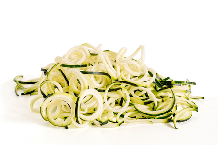 Front view of raw zucchini noodles (zoodles) isolated on white. Reklamní fotografie