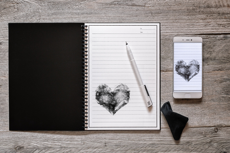 Top view of stone paper reusable, wipeable, rewritable notebook with pen and wipe cloth, digitizing creativity concept Reklamní fotografie - 83954113
