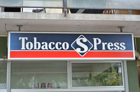 BERANE, MONTENEGRO - August 14, 2019: Tobacco S Press sign in front of a Tobacco Shop in an apartment building in the city centre of Berane in the North of Montenegro.