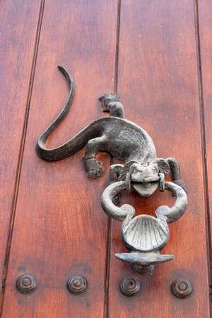 iguana: Door knocker Iguana shaped Stock Photo