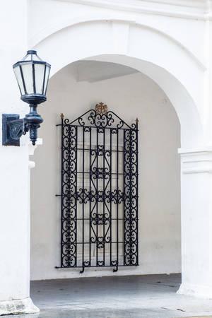 cartagena: Antique street lantern and window grid  in Cartagena de Indias