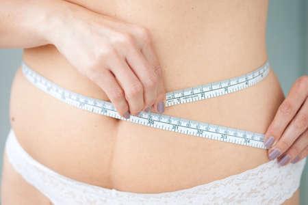 waist: Measuring waist circumference Stock Photo