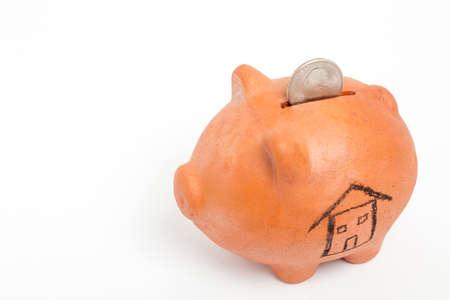 high angle: Saving dollars for a new house - high angle