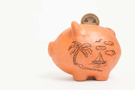 coin bank: Saving colombian money for vacations -  side view
