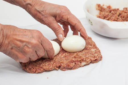 meatloaf: Preparing and filling the Egg and Vegetables stuffed meatloaf Stock Photo