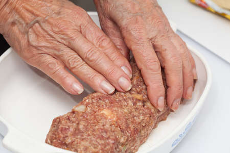 meatloaf: shaping a raw egg and vegetables stuffed meatloaf
