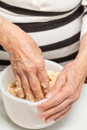 knead: Knead dough by hand Stock Photo