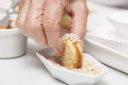 the edge: Adding nuts to cookies edge Stock Photo