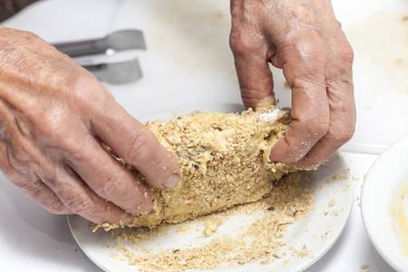 bleu: Breading a cordon bleu - adding crumbled cracker