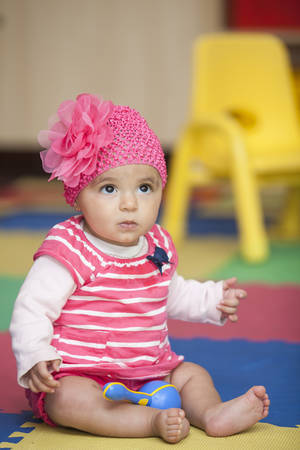 tender tenderness: Baby girl dressed in pink with a rumba shaker
