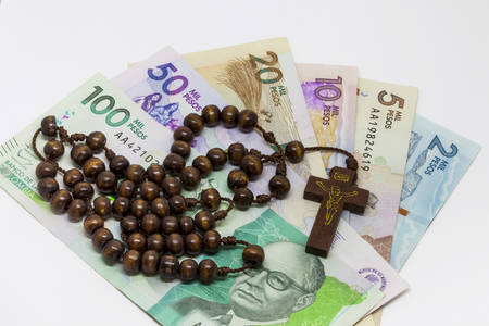 Conceptual image about money and religion