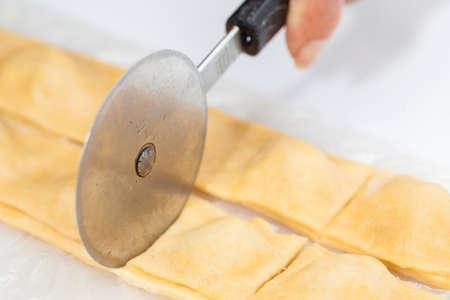 raviolo: Ravioli Preparation : Cutting the stuffed ravioli strips