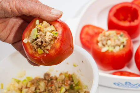 emptied: Stuffed tomatoes preparation : Stuffing the emptied tomatoes