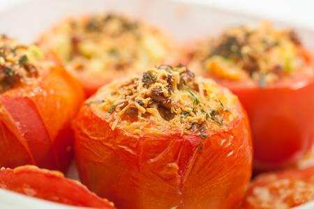 lose up: Stuffed tomatoes preparation : Just baked stuffed tomatoes Stock Photo