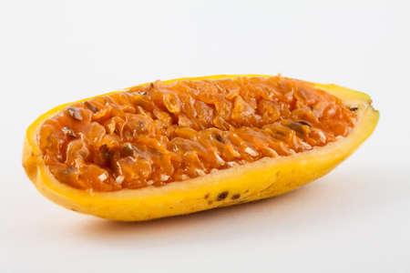 Exotic tropical fruit called curuba (Passiflora tripartita) on white background