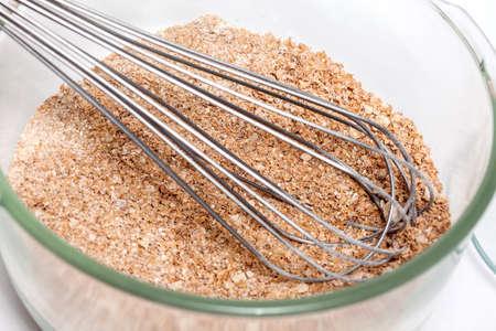 panela: Wheat bran muffins preparation : Mixing dry ingredients to prepare integral wheat bran muffins