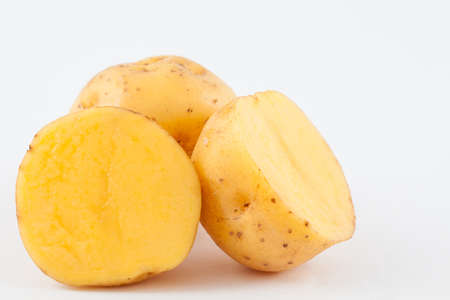 Yellow potato (Solanum phureja) isolated in white background Stock Photo