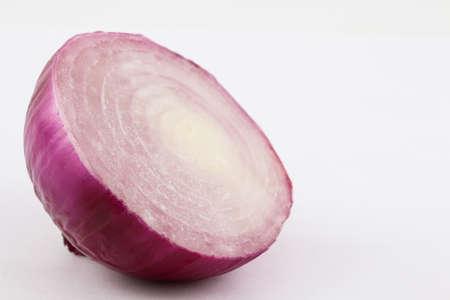 allium cepa: Red bulb onion (Allium cepa) isolated in white background