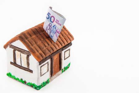 thousand: Saving Fifty Thousand Colombian Pesos Bills to buy a house Stock Photo