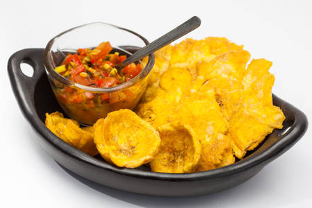 creole: Plantain cups and patacones with white background