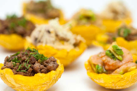 stuffing: Plantain cups filled with different types of stuffing on white background
