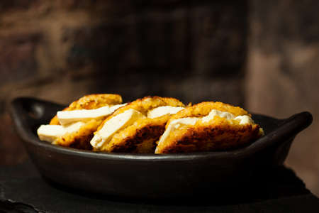 maize flour: Traditional Colombian Arepa de Choclo Preparation: Chopped arepas filled with white cheese Stock Photo