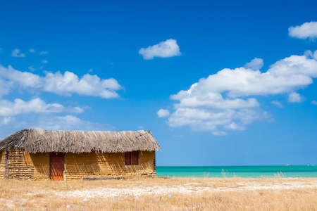 Colorful house next to the sea under blue sky