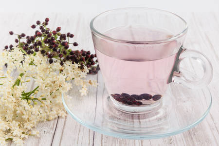 Elderberry (Sambucus nigra) infusion in water Stock Photo