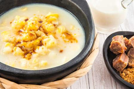 panela: Traditional Colombian corn mazamorra served in black ceramic dish