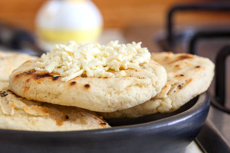 Traditional Colombian white corn arepa with cheese