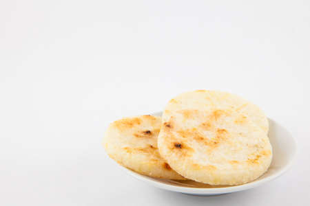 Roasted traditional Colombian white corn arepa Stock Photo