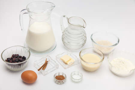 Rice Pudding with cinnamon and raisins preparation: Ingredients for sweet rice pudding Stock Photo