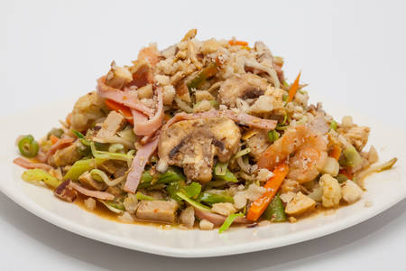 Sauteed vegetables with chicken, pork, jam and shrimps preparation: Ready served wok-Sauteed vegetables and meats