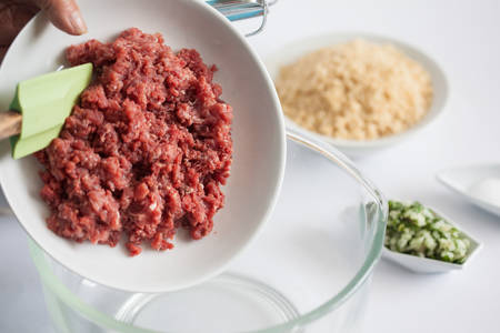 Step by step Levantine cuisine kibbeh preparation : Adding the ingredients to prepare kibbeh into a bowl