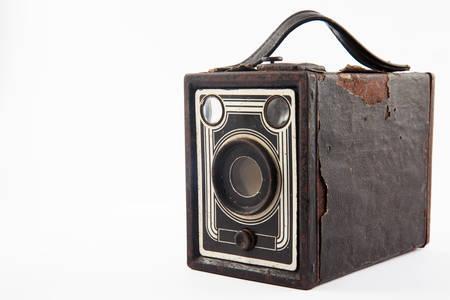 old photo: Antique camera isolated on white background Stock Photo