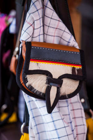 Colombian traditional leather satchel from the Antioquia Region called Carriel and poncho
