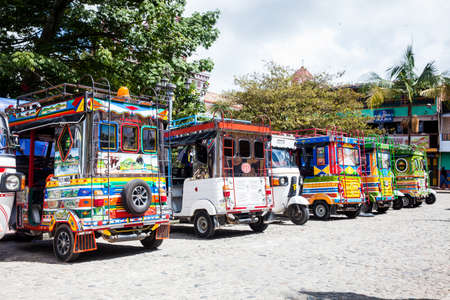 Motor-tricycles decorated as traditional Colombian chivas at the colorful Guatape city