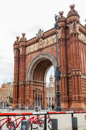 Public bike system bicycles nex to the Triumphal Arch in Barcelona Spain