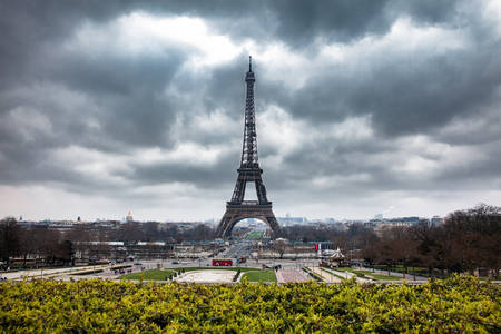 The famous Tour Eiffel at the end of winter under storm clouds Editorial