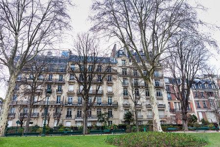 PARIS, FRANCE - MARCH, 2018: Buildings around the Champs de Mars next to the Eiffel Tower